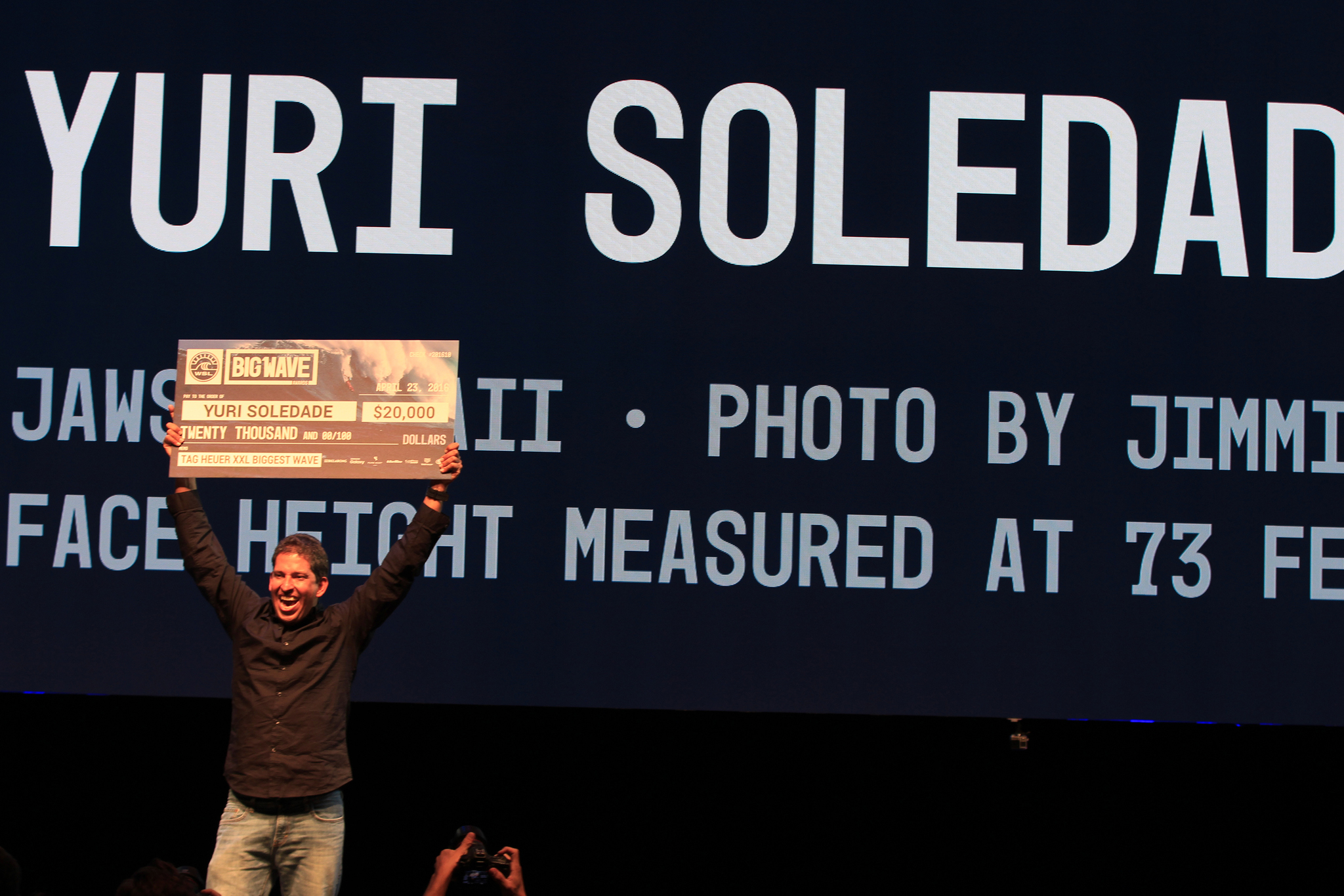 Yuri Soledad claims his prize at the XXL Big Wave Awards Photo: WSL