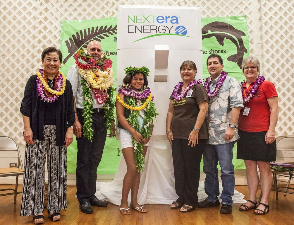 A celebration assembly was held Friday, April 8, at Kaunakakai Elementary to mark the completion of a hybrid solar air conditioning installation project. Sixth-grader and Student Council President Leonahemaikekaimalie Crivello was commended for helping the project become a reality. Photo credit: Kaipo Kiaha (Oiwi Television) via Hawaiʻi Department of Education.