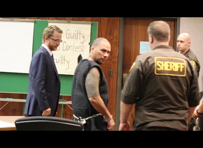 Defendant Stephen Schmidt glances back as he is escorted out of the courtroom following Wednesday's preliminary hearing.