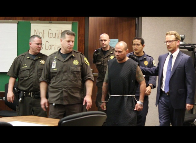 Defendant Stephen Schmidt was escorted into Wailuku District Court dressed in a dark colored padded over garment with shackles to his hands and feet.