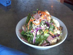 "The fully-loaded ""Plack Salad"" on Manoli's menu. Photo by Kiaora Bohlool."