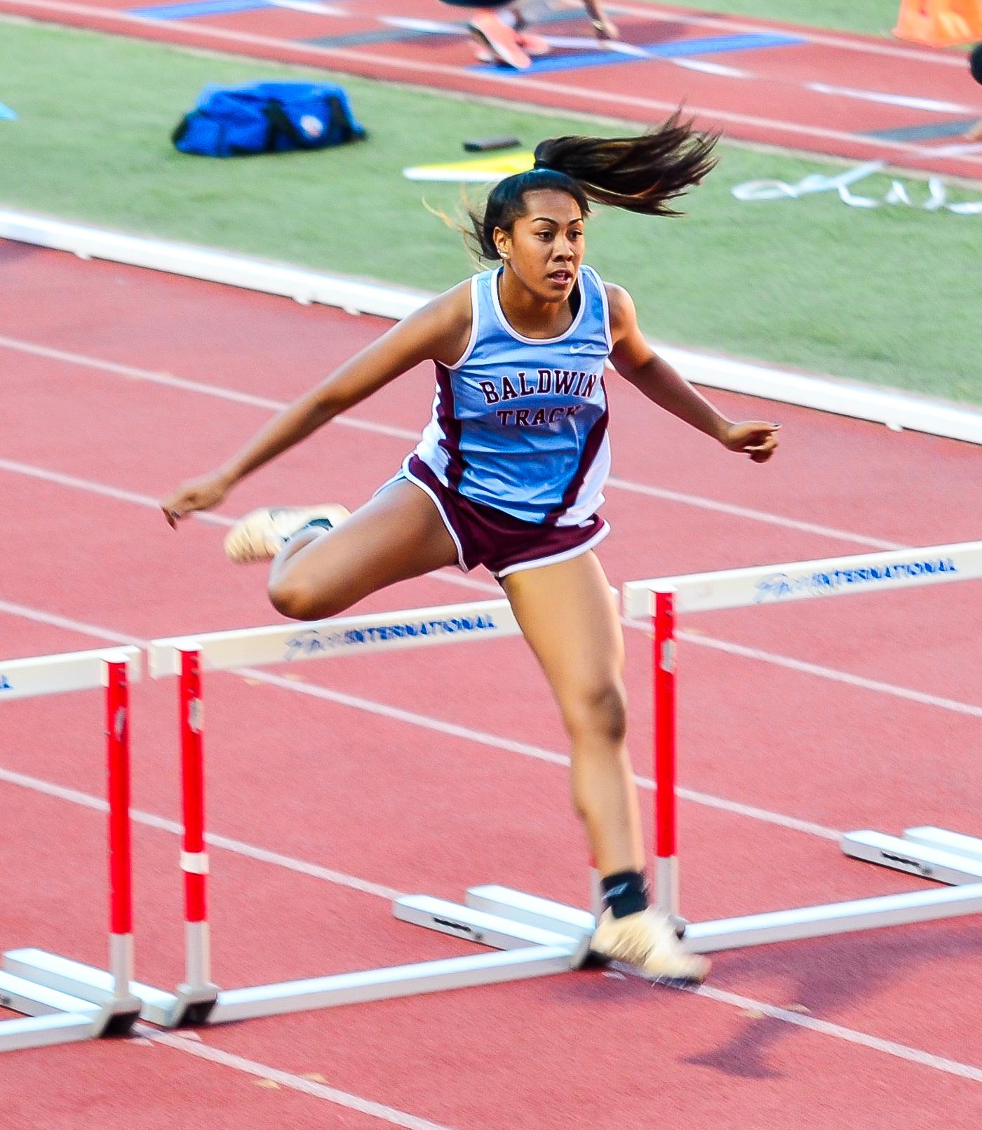 Baldwin's Kacy-Lyn Navarro finished fifth in the 300 hurdles. Photo by Rodney S. Yap.