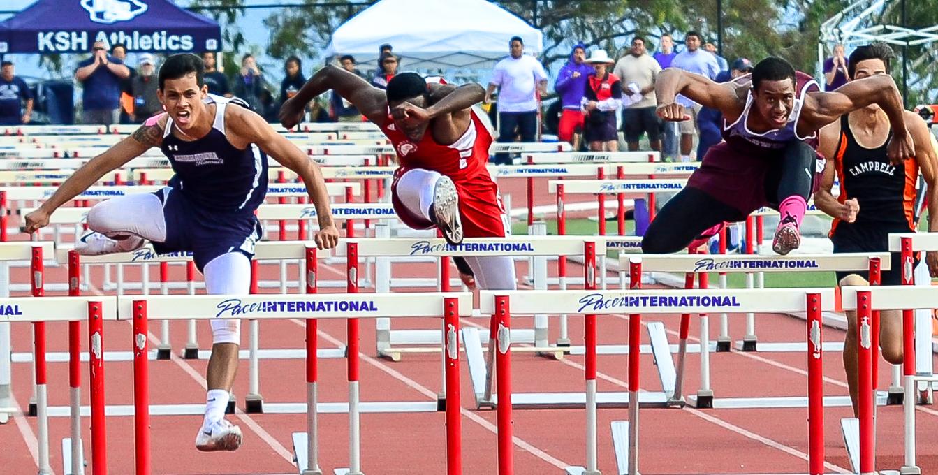 Kamehameha Hawaii hurdler Tre Evans-Dumaran (left) won the boys high hurdles in 14.75 seconds. Lahainalua's Kamal Golaube was second in 15.06 and Baldwin's La'akea Kahoohanohano-Davis was third in 15.07. Photo by Rodney S. Yap.