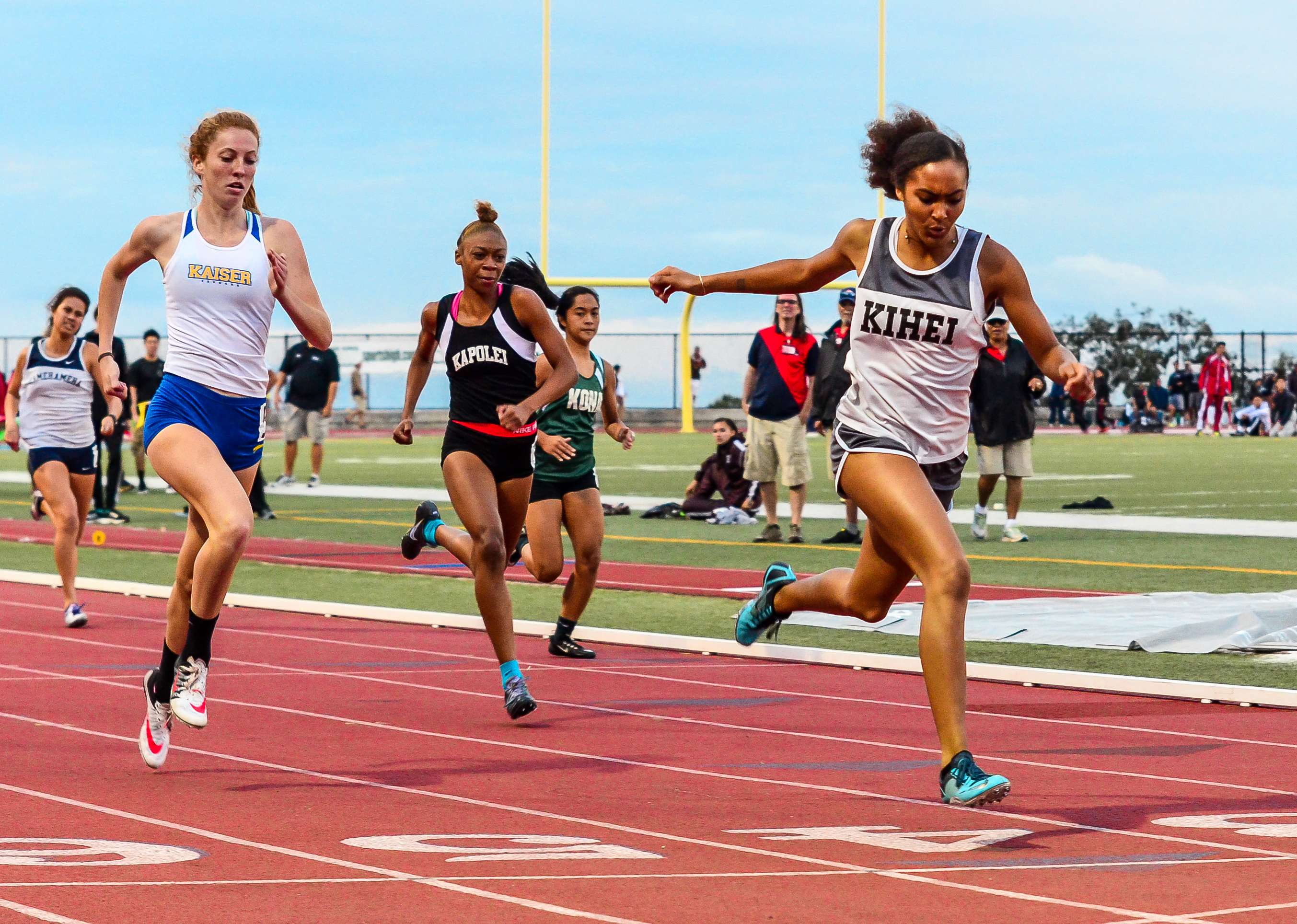 Kihei Charter's Maya Reynolds wins the 400-meter run to collect the MIL's only gold medal in the girls division last Saturday. Photo by Rodney S. Yap.