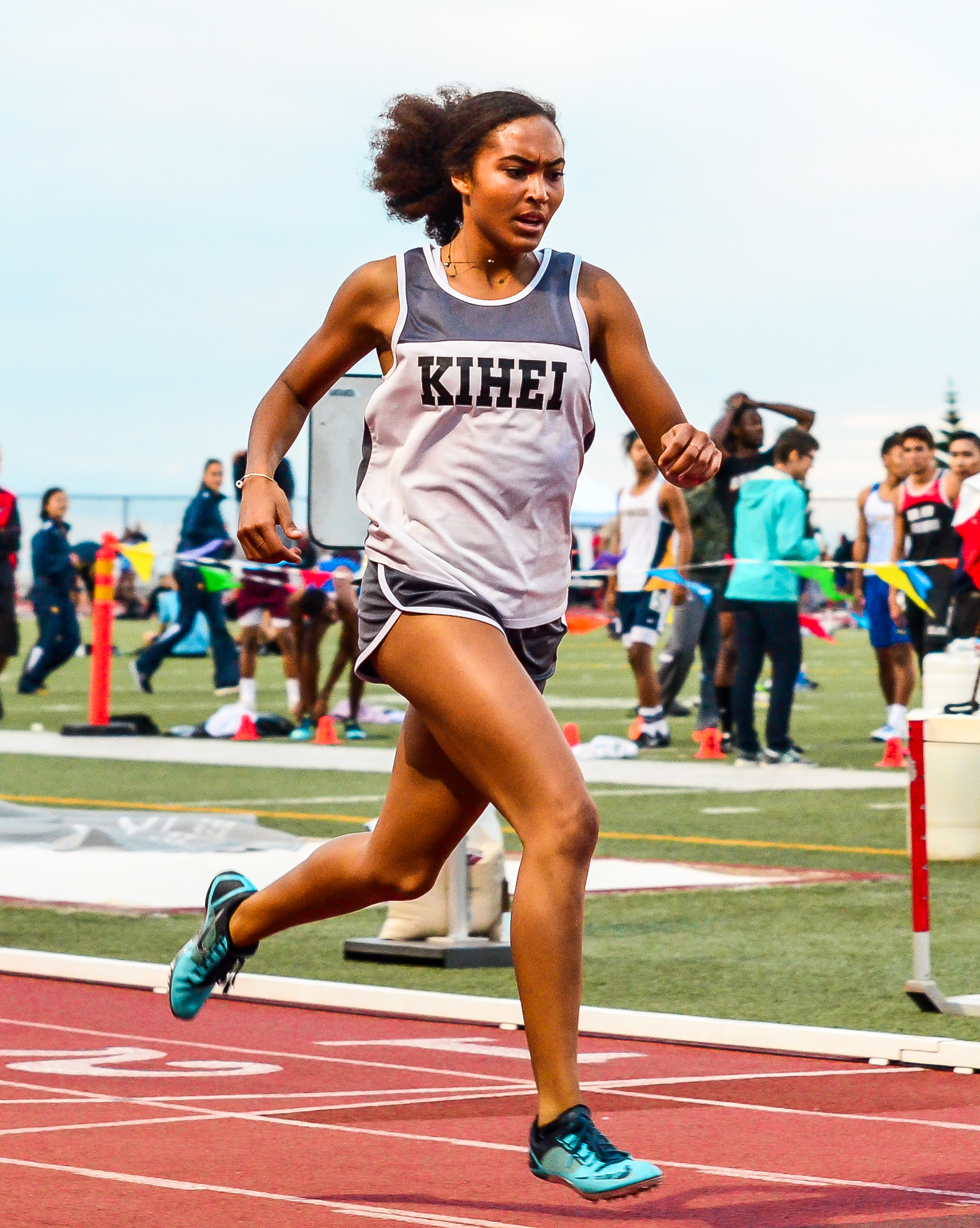 Kihei Charter's Maya Reynolds earn the MIL's only gold medal in the girls division, coming in the 400-meter dash. Photo by Rodney S. Yap.