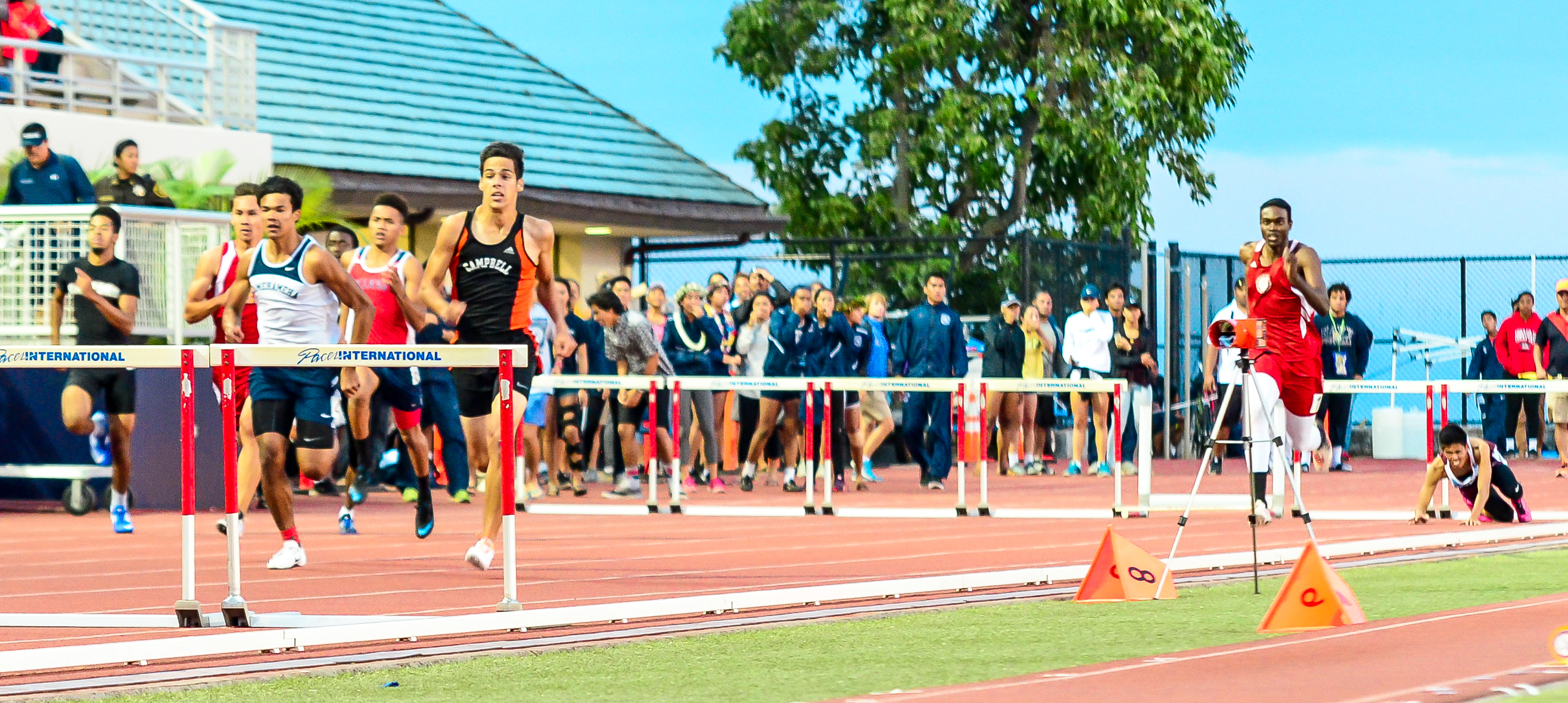 Baldwins Keirnan Mateo (far right) fell in the 300 hurdles, but Lahainaluna's Kamal Golaube finished fourth in 40.05 seconds. Photo by Rodney S. Yap.