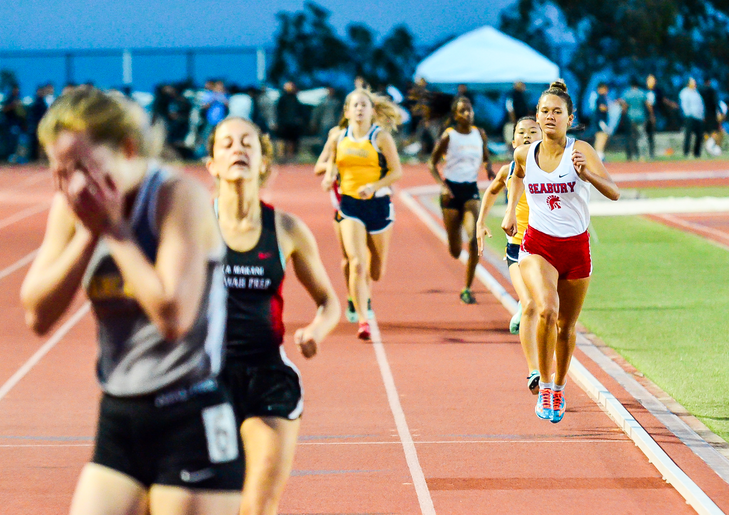 Sacred Hearts Academy's Phoebe Kirk wins the 800 as Seabury Hall's Ava Shipman was third in 2:24.46. Photo by Rodney S. Yap.