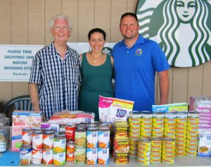 Upcountry Rotarians Harlan Hughes (from left), Carly Heims, and Club President Zak Pacholl collect donations at Foodland in Pukalani for the Maui Food Bank.