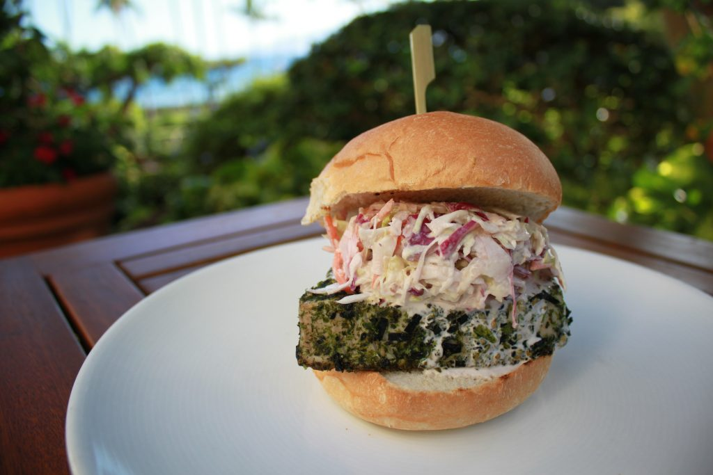Ahi Burger with furikake crusted ahi, sweet oyster sauce, wasabi aioli, Wailuku homemade potato roll, upcountry lettuce, onion, tomato and pickle. Photo Courtesy Hyatt Regency Maui Resort & Spa.