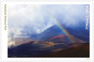 The Forever Stamp will depict Maui's famed Haleakalā National Park, featuring an image of a rainbow within the crater, taken by Seattle photographer Kevin Ebi.