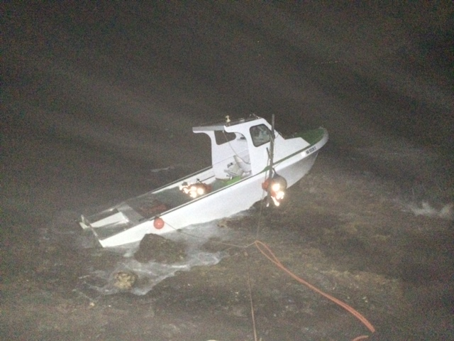 """Grounded vessel at """"Little Beach"""" in the South Maui area of Mākena. Photo credit: DLNR."""