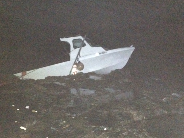"Grounded vessel at ""Little Beach"" in the South Maui area of Mākena. Photo credit: DLNR."