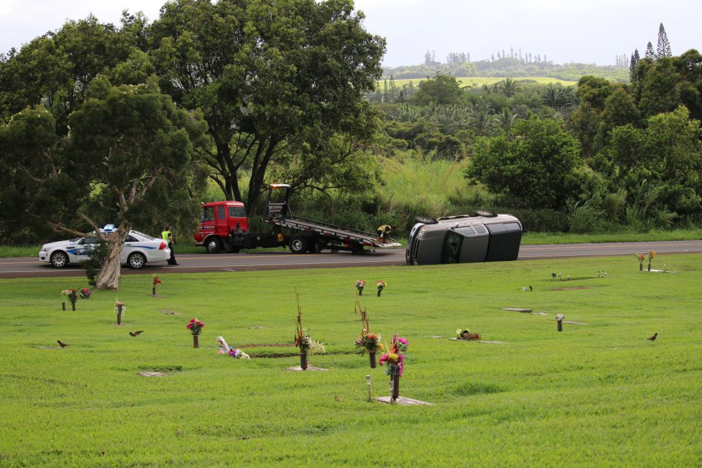 Overturned vehicle fronting the Valley Isle Memorial Park. Photo credit: Nicole Schenfeld