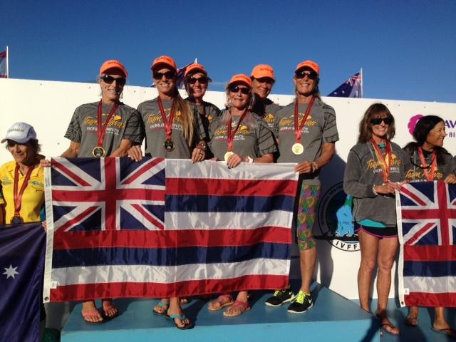 The Island Masters select crew, that won the 1,000-meter final for women 60 and older, receives gold medals at ceremonies Saturday at Sunshine Coast Stadium in Queensland, Australia. Crew members are (from left) Camie Kimball of Wa`akapaemua Canoe Club of Molokai; Vanessa Weiss of Kihei Canoe Club, Maui; Bev Tuaolo of Puna Canoe Club, Hawai`i island; Sherri Carney of Kai `Opua Canoe Club of Kona; Penny Martin of Wa`akapaemua, and Patty Eames of Keoua Canoe Club, Hawai`i island. Photo credit: Mary Akiona.