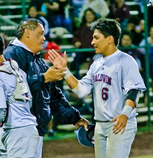 Baldwin head coach Jon Viela congratulates senior Haloa Dudoit. Photo by Ben Juan.
