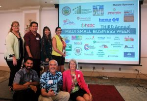 The third annual Maui Small Business Week opened on Monday, May 9: (left to right, standing) Teena Rasmussen, David Kapaku, Karen Arakawa, Nicole Fisher (seated) Kainoa Horcajo, John Hau'oli Tomoso and Lori Fisher. Maui SBW photo.