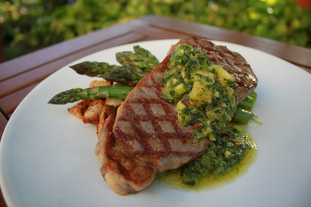 New York Strip Steak with volcano spiced roasted potatoes, Maui farm vegetables and a pineapple chimichurri. Photo Courtesy Hyatt Regency Maui Resort & Spa.