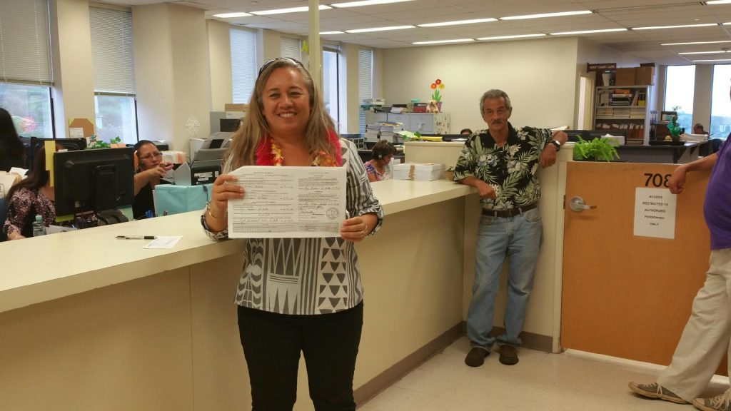 Rep. Lynn DeCoite holding her papers at the Maui County Clerks Office