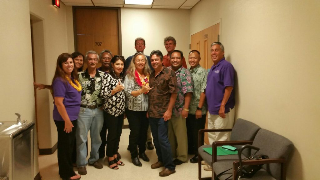 Rep. Lynn DeCoite filing her papers with her husband Russell DeCoite and friends in the Maui County Clerks Office