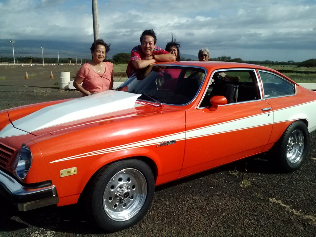A vintage Thunderbird is admired by owner Dean Yamada (from right) of Maui Classic Cruisers, and friends Jackie Yamamoto, Mark Mizuno and Eloisa Mizuno. The public is invited to see and be photographed with such resplendent roadsters at the June 19 Keokea Father's Day event with classic cars.