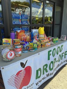 Donations fill a table at Lahaina Safeway. Courtesy photo.