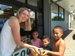 Melissa Crawley, representing the Rotary Club of Lahaina Sunset, accepts donations at the Lahaina Safeway from Nita Faleofa, Fono Faleofa and Paulo Galoia. Courtesy photo.