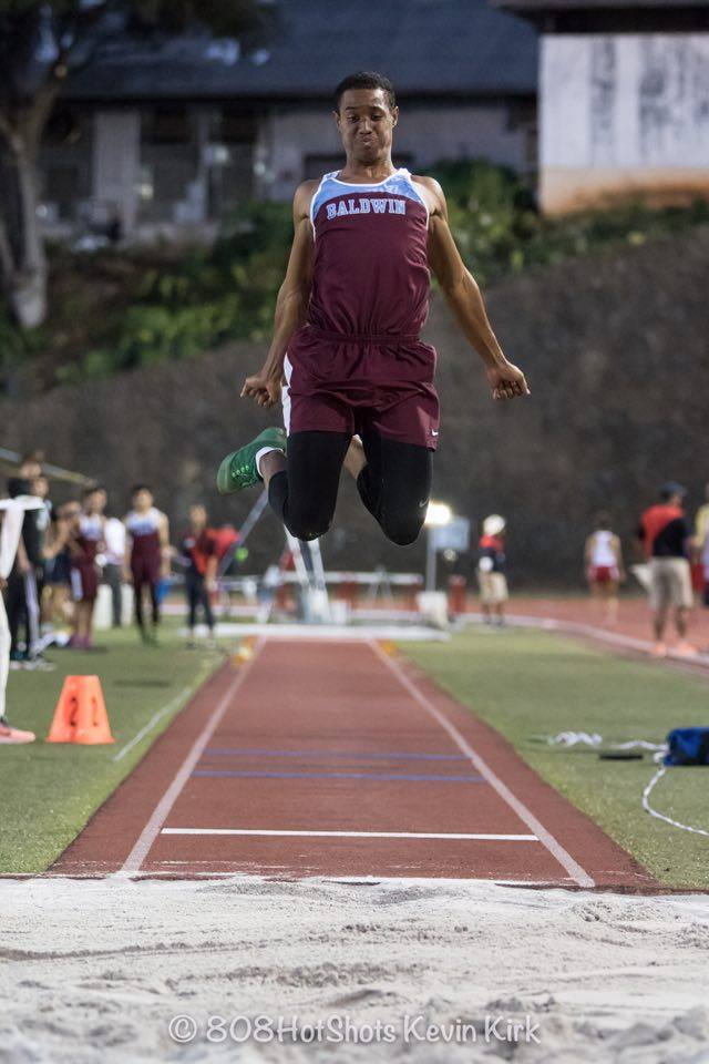 Baldwin's La'akea Kahoohanohano-Davis about to land his record-breaking 49-10 3/4 in the boys triple jump last Friday on Oahu. Photo by Kevin Kirk.