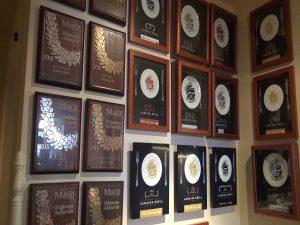Wall of awards at Lāhainā Grill. Photo by Kiaora Bohlool.