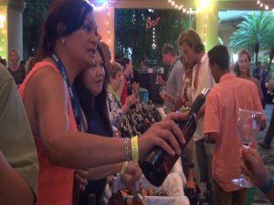 Wine makers pour glasses at Kapalua Wine & Food Festival. Photo by Kiaora Bohlool.