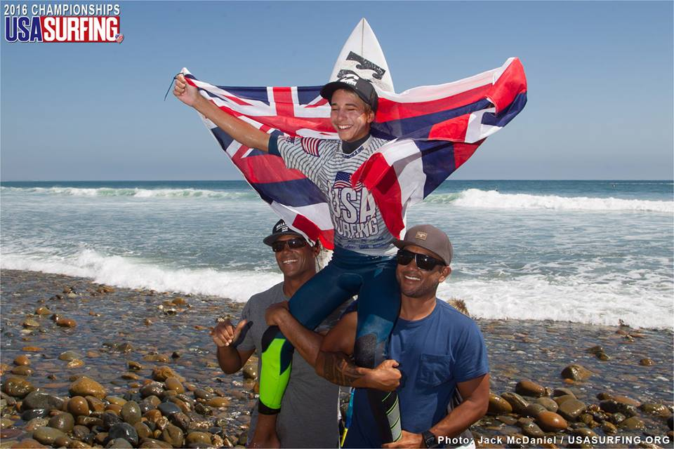 Ocean Macedo gets chaired up the beach at Lower Trestles to claim his victory in the Boys Under 14 division. Photo: USA Surfing