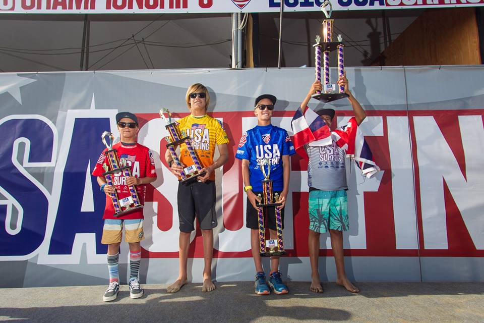 Ocean hoisting his 1st Place trophy in honor of the Hawaiian State. Photo: USA Surfing