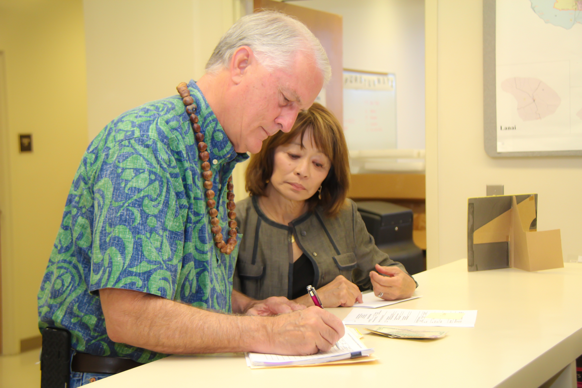 Council Chair Mike White filing for reelection at the County Clerk's Office with long-time Campaign Manager Leslie Ann Yokouchi.