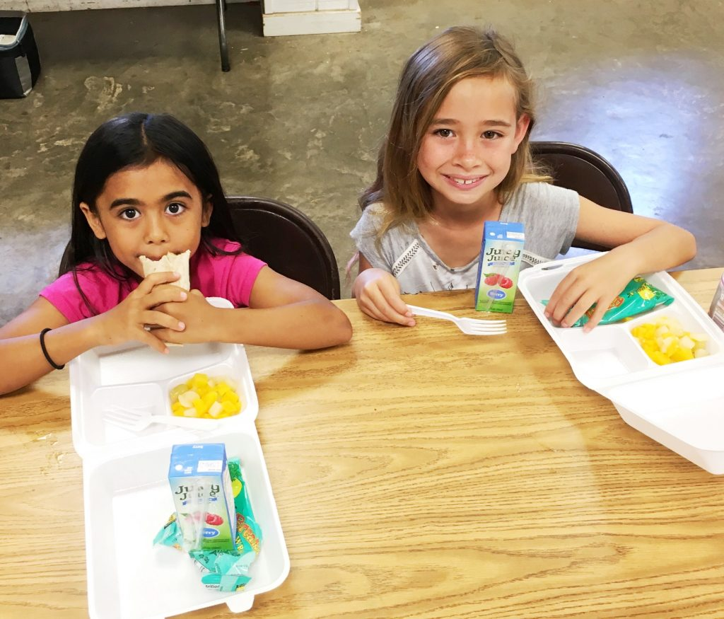Second graders Muzik Kekiwi Vares and Tayon Spencer eat breakfast at Kahului Community Center (KCC) PALS. Photo credit: County of Maui, Dept. of Parks and Recreation (Ryan Min).