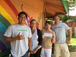 Travis Morrin and Jaron Blosser of Three's Bar & Grill present a donation check to Maui Humane Society. Courtesy photo.
