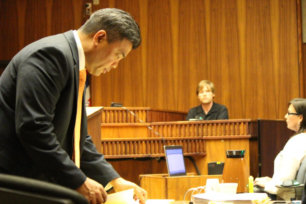 Ginseng Mileur in on the witness stand and prosecuting attorney Robert Rivera in the foreground. (6.27.16) Photo by Wendy Osher.