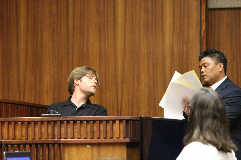 Ginseng Mileur in on the witness stand and prosecuting attorney Robert Rivera to the right. (6.27.16) Photo by Wendy Osher.