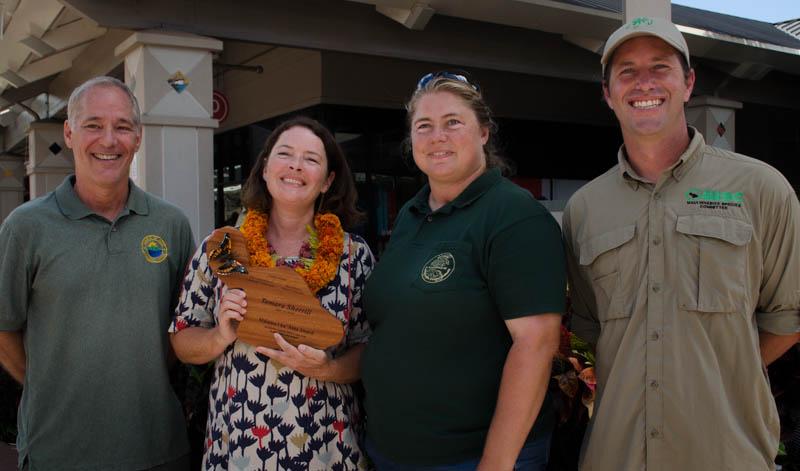 From Left: Rob Parsons, Tamara Sherrill, Allison Wright, and Adam Radford present Mālama i ka ʻĀina Award at Maui Mall on Saturday. Photo Courtesy.