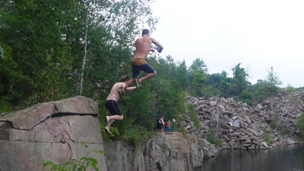 Swimmers take a flying leap from the red granite cliffs of Minnesota's Quarry Park. Photo credit: Travel Channel.