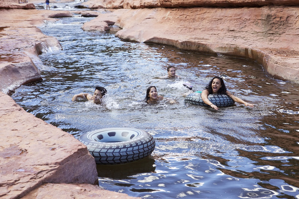 Swimmers float along Arizona's Slide Rock, a red-walled wonder with a slippery natural waterslide. Photo credit: Travel Channel.