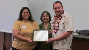 Dawn DeRego (right), Na Hale O Maui's outgoing president, and Cassandra Abdul, NHOM's new executive director, present Justin Hughey with a certificate of appreciation, honoring his six years of service as a board member with NHOM from 2010 to 2016.