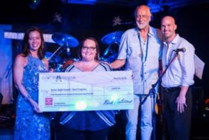 Fleetwood's on Front Street presents check to Easter Seals Hawai'i. Courtesy photo