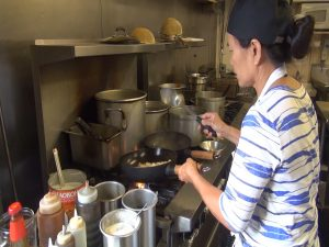 Chef Prakong, busy at work in the kitchen at Maui Thai Bistro. Photo by Kiaora Bohlool.