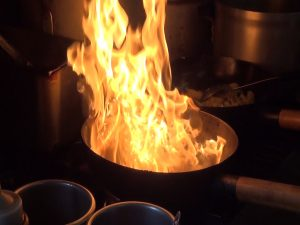 Food fires up on the stove at Maui Thai Bistro. Photo by Kiaora Bohlool.