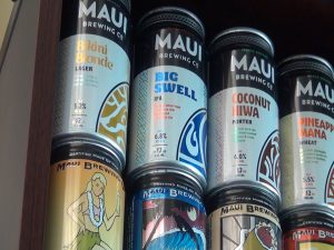 Original Maui Brewing Co. can design on the bottom, newly-branded cans on the top. Photo by Kiaora Bohlool.
