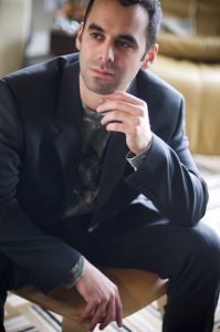Adam Tendler in Robert Wichman's living room.