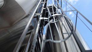 Huge fermentation tanks outside the brewery. Photo by Kiaora Bohlool.