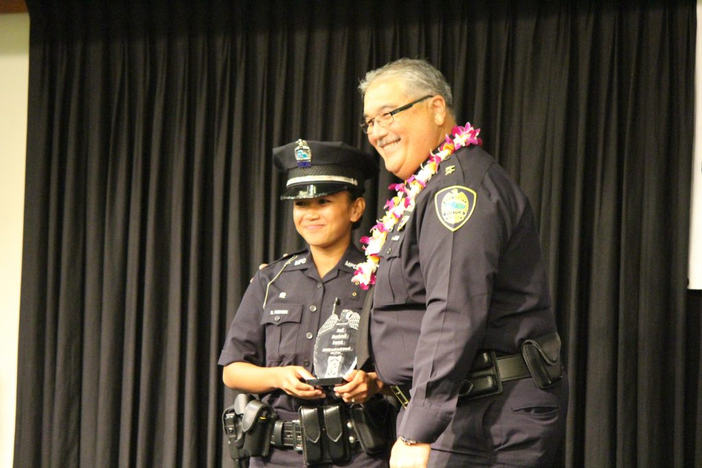 Mary Rose Reiner receiving the Best Notebook Award. Maui Police Department 83rd Recruit Class and Emergency Services Dispatchers Graduation. Photo by Wendy Osher.