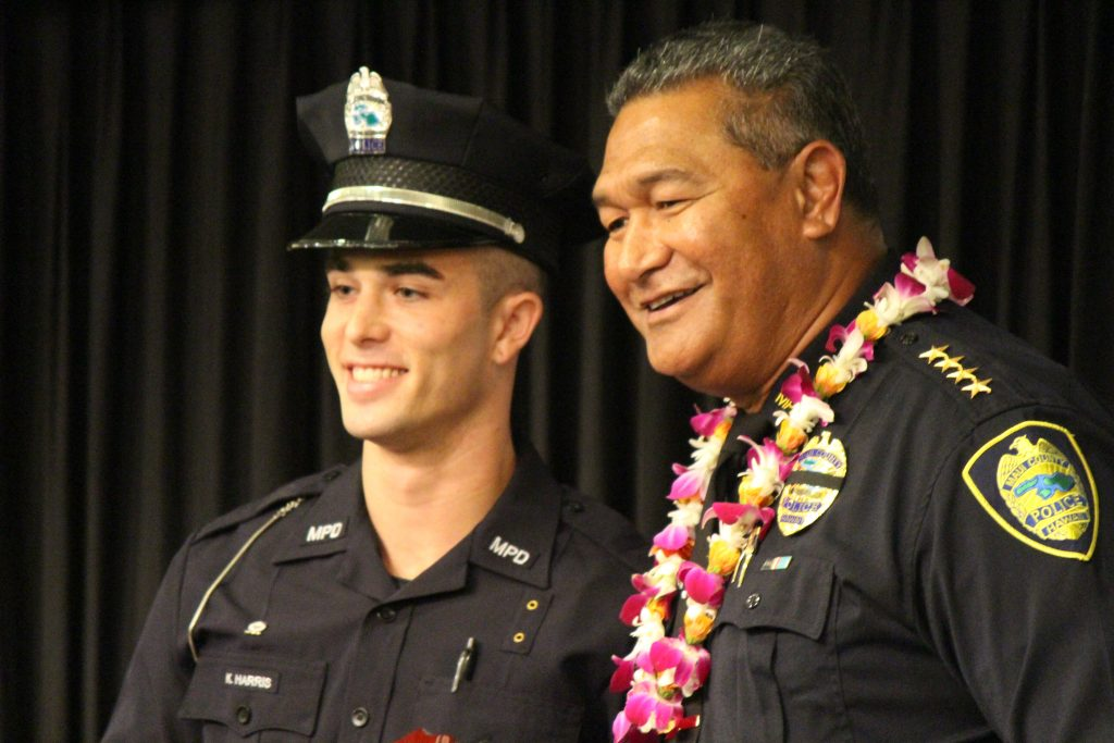 Korey Harris receiving the Outstanding Recruit Award. Maui Police Department 83rd Recruit Class and Emergency Services Dispatchers Graduation. Photo by Wendy Osher.