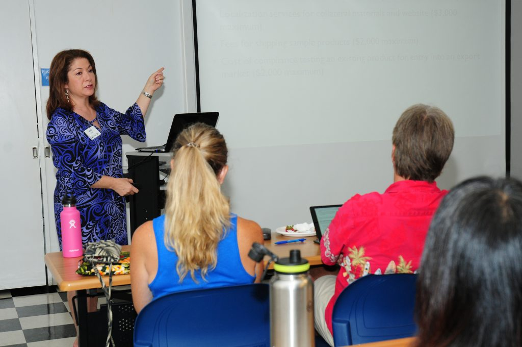 Jamie Lum of DBEDT spoke to workshop attendees on the Hawai'i State Trade and Export Promotion Assistance Program, which helps qualified companies with export marketing assistance.DBEDT photo.