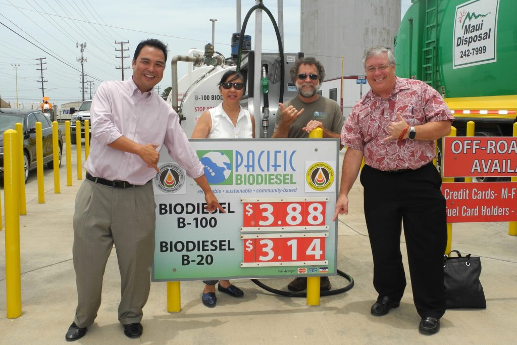 Maui County Council Vice Chair Don Guzman, who proposed the tax exemption, shows his support for the biodiesel price rollback earlier today with Kelly and Bob King, Pacific Biodiesel founders, and Councilmember Don Couch. Photo credit: Pacific Biodiesel